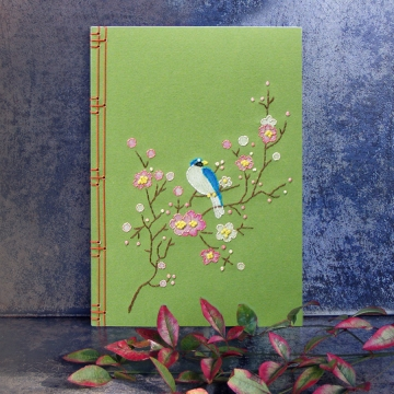 Spring Journal. Blooming Branch with a Little Blue Bird